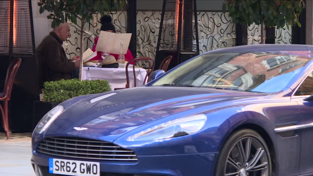 exterior shots of luxury cars parked on the streets of mayfair including close up shots of shop windows and signs of 'rubinacci' and 'parmigiani' on... - wealth stock videos & royalty-free footage