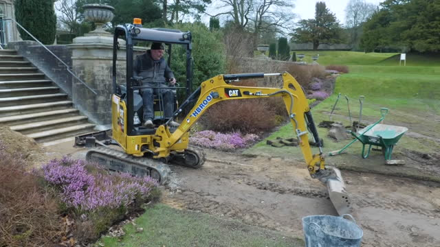 exterior shots of lyme house and extensive landscaped gardens and ponds, a national trust property, as a worker uses a mechanical digger to resurface... - landscaped stock videos & royalty-free footage