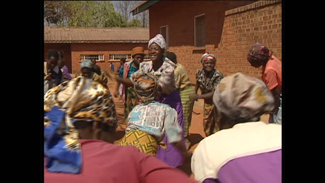 exterior shots of malawian women dancing in a circle and singing together on august 12, 2002 in malawi. - malawi stock videos & royalty-free footage