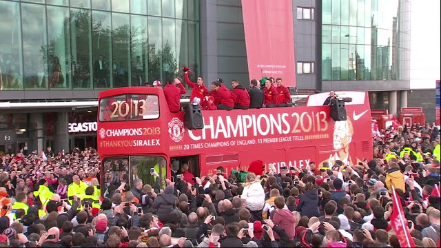 exterior shots of man united football team on top of champions parade bus holding premier league trophy, singing and celebrating on 13th may 2013 in... - 2013 stock videos & royalty-free footage