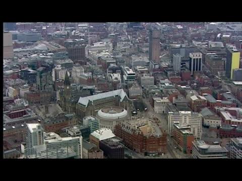 vídeos de stock e filmes b-roll de exterior shots of manchester city centre including town hall exterior shots of the city of manchester stadium home of manchester city football club - town hall