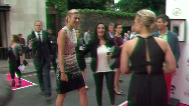 exterior shots of maria sharapova on the pre wimbledon party red carpet at kensington rooftop gardens in london maria sharapova pre wimbledon red... - red carpet event stock videos & royalty-free footage