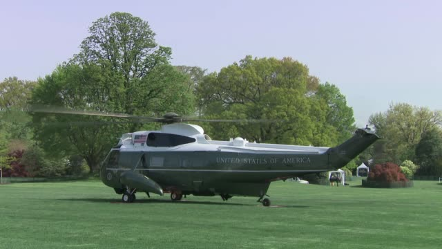 exterior shots of marine one helicopter carrying donald trump and wife melania takes off from the white house lawn on 18 april 2019 in washington dc... - military helicopter stock videos & royalty-free footage