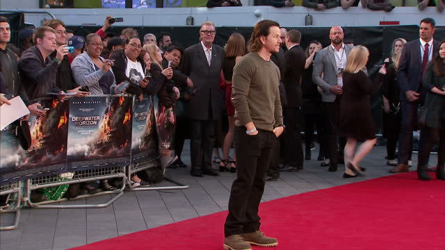 Exterior shots of Mark Wahlberg posing for photos on the red carpet at the premiere of Deepwater Horizon at Leicester Square on September 26 2016 in...