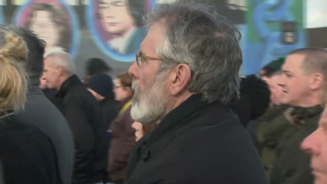 exterior shots of martin mcguinness' coffin being carried through the bogside area of derry draped with the irish tricolour at the head of a large... - gerry adams stock videos and b-roll footage
