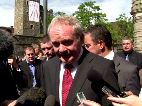 stockvideo's en b-roll-footage met exterior shots of martin mcguinness sinn fein mp commenting on his wish for justice and how it will help the peace process - britse leger