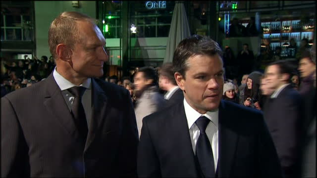 Exterior shots of Matt Damon and Francois Pienaar on red carpet of Invictus film premiere and speak about being part of film and how incredible it...