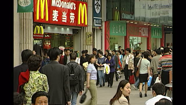 exterior shots of mcdonalds an advert for the bank of shanghai chinese toy dolls in a shop window on april 18 2000 in shanghai china - mcdonald's stock videos & royalty-free footage