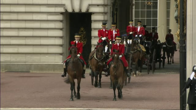 Exterior shots of Meghan Duchess of Sussex and Prince Harry Duke of Sussex share a horse drawn carriaged with Camilla Duchess of Cornwall and...