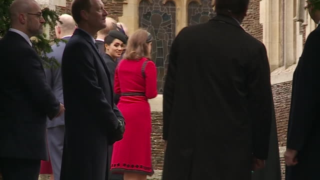 Exterior shots of Meghan Duchess of Sussex Catherine Duchess of Cambridge next to Prince Harry outside Sandringham church for the Christmas Day...