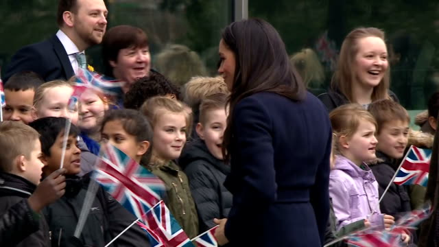 exterior shots of meghan markle greeting members of the public and schoolchildren gathered outside millennium point in birmingham before attending an... - internationaler frauentag stock-videos und b-roll-filmmaterial
