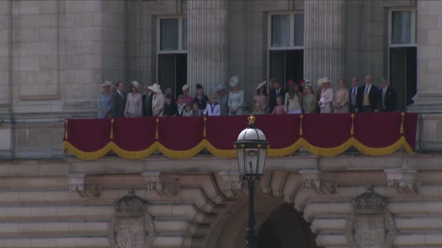 Exterior shots of members of The Royal family stood on the balcony of Buckingham Palace as The Royal Household Cavalry arrives after the Trooping of...