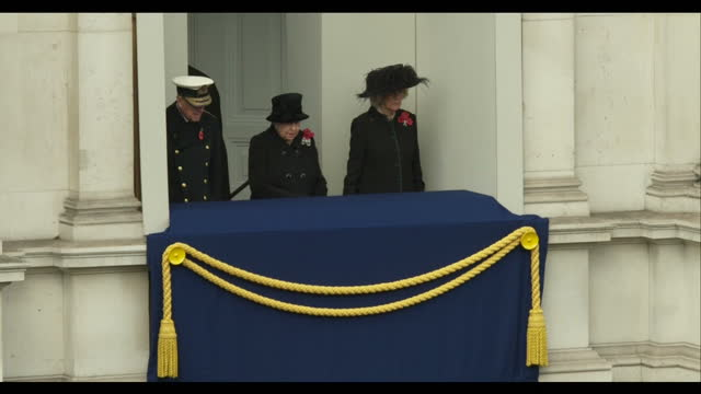 exterior shots of members of the royal family taking their places for remembrance sunday commemorations at the cenotaph including shots of prince... - remembrance sunday stock videos & royalty-free footage