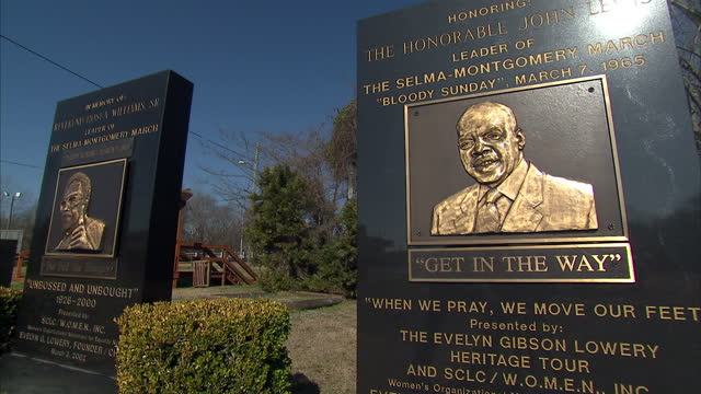 Exterior shots of memorial plaques commemorating the leaders of the Selma to Montgomery civil rights march who were killed on 'Bloody Sunday' in 1965...