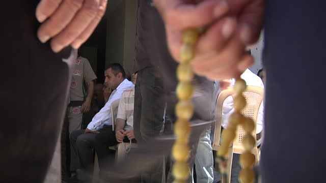 exterior shots of men arriving and greeting each other at a funeral and a man holding prayer beads on july 17 2014 in gaza israel - prayer beads stock videos & royalty-free footage
