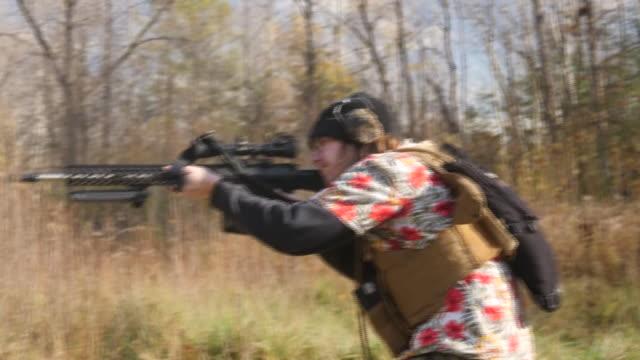 exterior shots of men firing semi automatic rifles and pump action shotguns on a firing range on 2 november 2020 in michigan, united states - michigan stock-videos und b-roll-filmmaterial