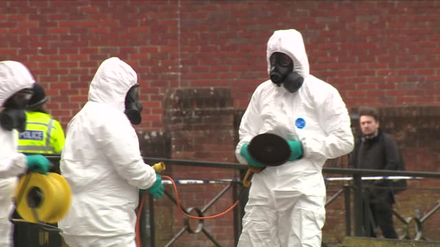 exterior shots of men in hazmat chemical protection suits using a disc cutter to remove the bench where poisoned ex spy sergei skripal and his... - sergei skripal stock videos and b-roll footage