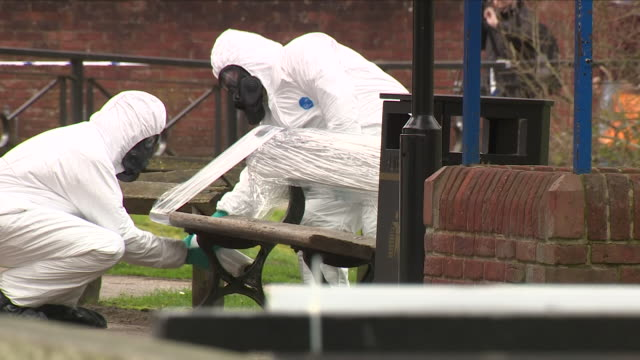 exterior shots of men in hazmat chemical protection suits wrapping tup a bench on which poisoned ex spy sergei skripal and his daughter yulia were... - sergei skripal stock videos and b-roll footage