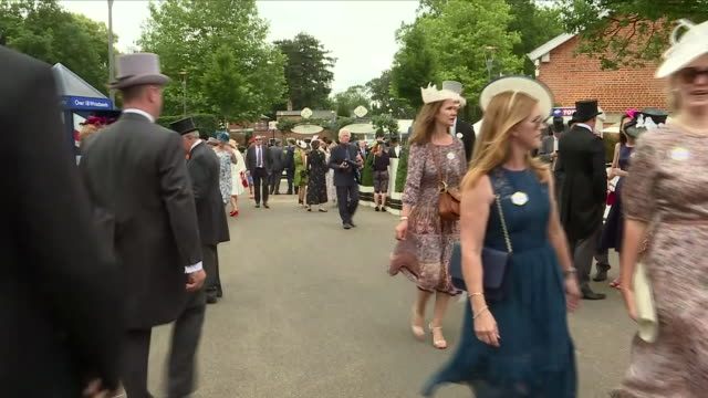 exterior shots of men in top hats and tails and women wearing formal summer dresses and facinators walking about enclosure at ascot racecourse on... - enclosure stock videos & royalty-free footage