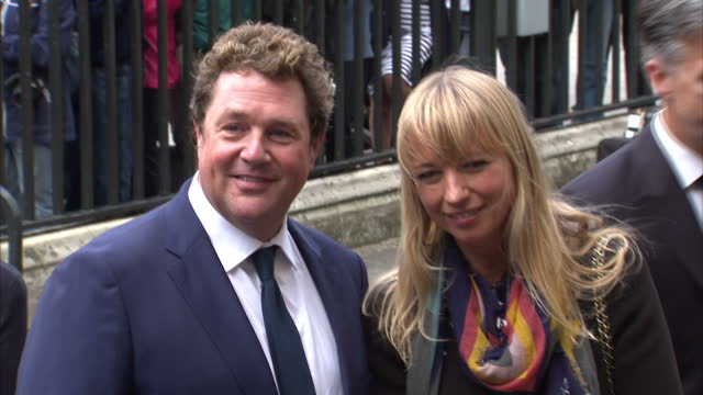exterior shots of michael ball and sara cox arriving for a memorial service for sir terry wogan at westminster abbey and posing for the press on... - terry wogan video stock e b–roll