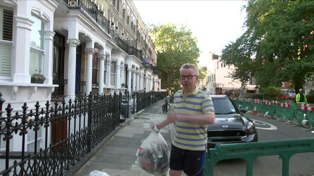 exterior shots of michael gove mp taking rubbish out and putting it on the pavement whilst answering questions about the brexit negotiations on 21... - michael gove stock-videos und b-roll-filmmaterial