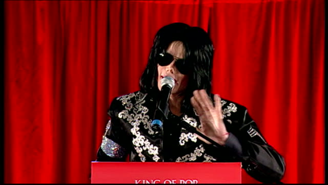 exterior shots of michael jackson at this is it press conference and tells the crowd about what song's he'll be performing and also that he loves... - マイケル・ジャクソン点の映像素材/bロール