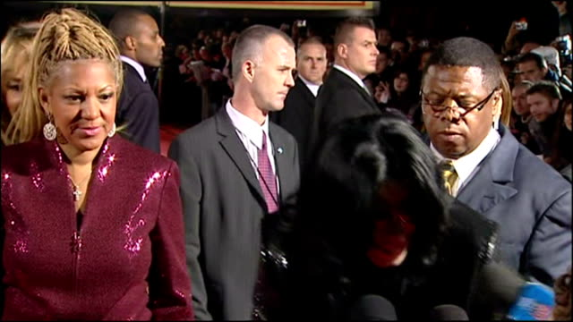 exterior shots of michael jackson on red carpet with reporters asking questions and taking photos of him with crowds cheering and shouting for... - 2006 stock videos & royalty-free footage