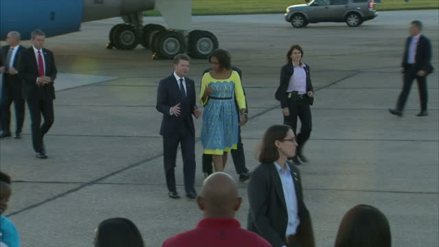 exterior shots of michelle obama first lady of the united states walking with matthew barzun us ambassador to the uk and greeting a row of people... - 2015 stock videos & royalty-free footage