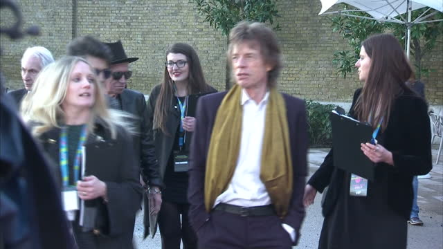 Exterior shots of Mick Jagger Ronnie Wood and Keith Richards chatting and joking around on the press line at the launch of the Rolling Stones...