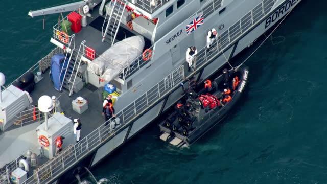 exterior shots of migrants being taken from their rubber dinghy onto a border force boat at sea on 18 august 2020 in dover, united kingdom. - kent england bildbanksvideor och videomaterial från bakom kulisserna