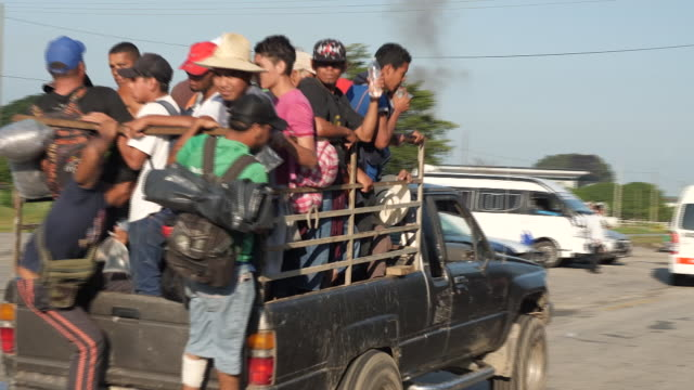 exterior shots of migrants travelling on trucks or on foot towards the us mexico broder on 25th october 2018 in mapastepec mexico - exile stock videos & royalty-free footage