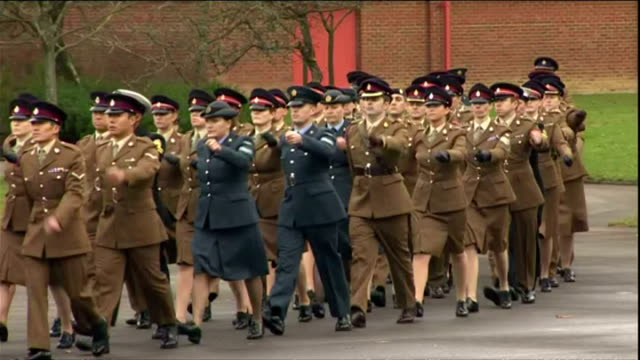 exterior shots of military band marching followed by british army medics who helped in the fight against ebola marching onto square at keogh barracks... - aldershot stock videos & royalty-free footage