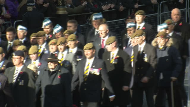 exterior shots of military personnel and veterans marching past the cenotaph on remembrance day watched by crowds on november 13 2016 in london... - remembrance sunday stock videos and b-roll footage