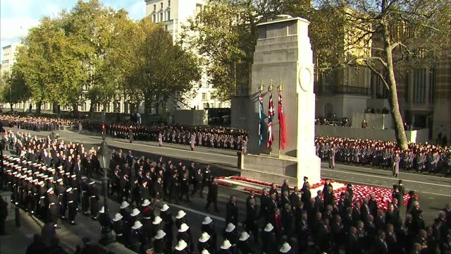exterior shots of military personnel and veterans marching past the cenotaph on remembrance day watched by crowds on november 13 2016 in london... - remembrance sunday stock videos & royalty-free footage