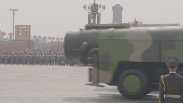 exterior shots of missiles and large rocket parts on transporter lorries taking part in a mass celebration parade through tiananmen square marking 70... - military stock videos & royalty-free footage