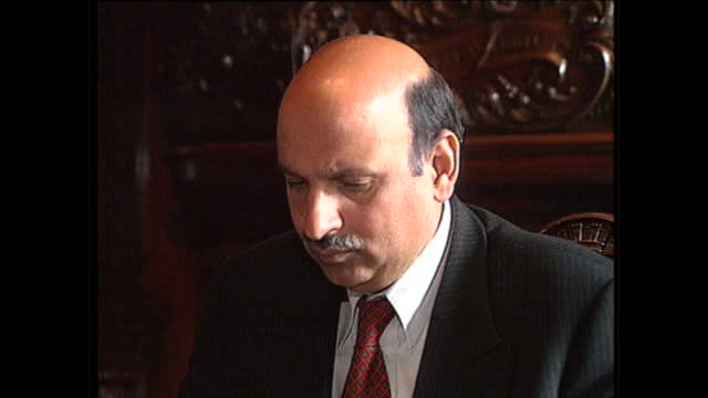 Exterior shots of Mohammad Sarwar MP for Govan looking through paperwork at a desk on May 19 1997 in Govan Scotland