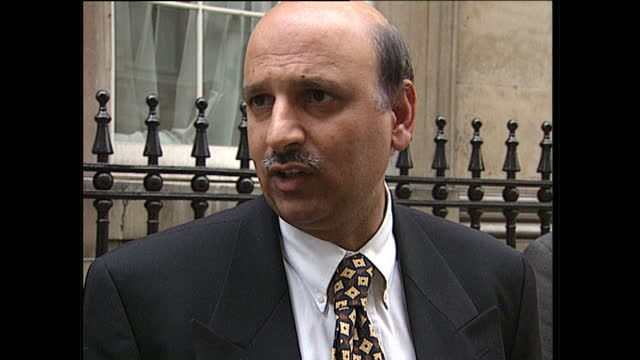 Exterior shots of Mohammad Sarwar MP for Labour departing Number 10 Downing Street with aide and answering journalists questions on an investigation...