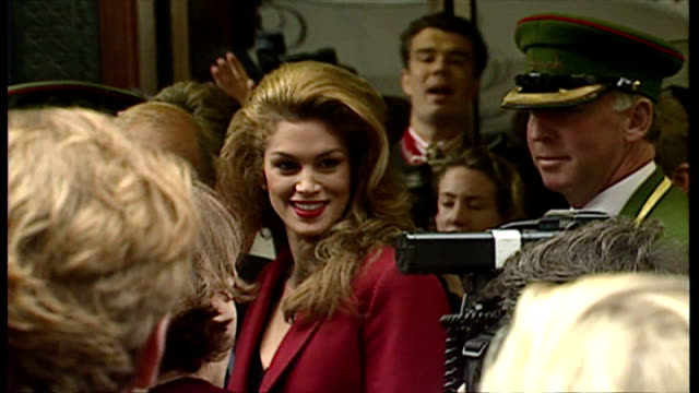 exterior shots of mohammed al-fayed and others waiting for cindy crawford to arrive for a revlon launch event at harrods, and cindy crawford posing... - cindy crawford stock videos & royalty-free footage