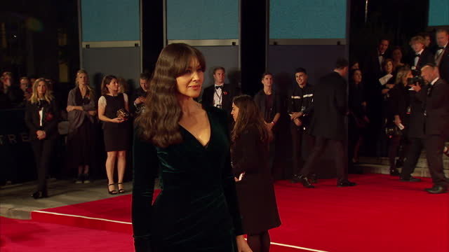 Exterior shots of Monica Bellucci posing for photo op on the red carpet at the Royal World Premiere of 'Spectre' at Royal Albert Hall on October 27...