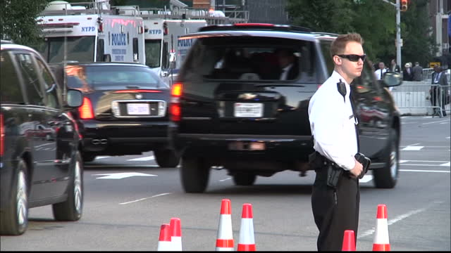 exterior shots of motorcade driving iranian president hassan rouhani arriving at the un meetings on september 24 2013 in new york united states - motorcade stock videos & royalty-free footage