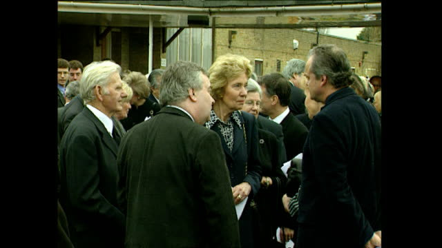 exterior shots of mourners after the funeral service of ernie wise including tom o'connor comedian and doreen wise widow on march 30 1999 in slough... - berkshire england stock videos & royalty-free footage