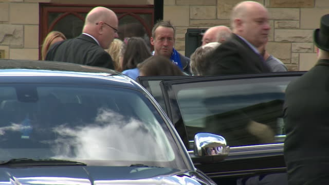 exterior shots of mourners filing from church after the funeral service for jack charlton on 22 july 2020 in ashington united kingdom - jack charlton stock videos & royalty-free footage
