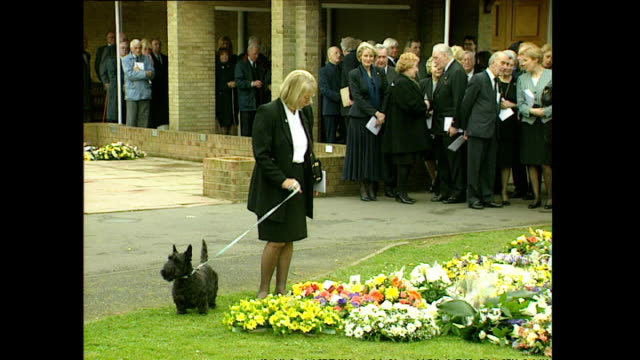 exterior shots of mourners walking from chapel including michael grade and doreen wise ernie wise's widow on march 30 1999 in slough england - widow stock videos & royalty-free footage
