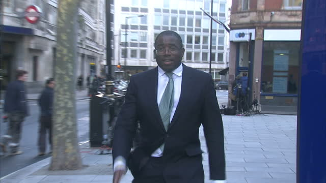 exterior shots of mp for tottenham david lammy arriving at scotland yard offices in london armed police to wear video camera's to rebuild trust in... - inquest stock videos & royalty-free footage