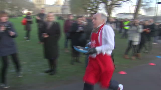 exterior shots of mp's, members of the house of lords and members of the media taking part in the rehab parliamentary pancake race, including steve... - mp stock videos & royalty-free footage