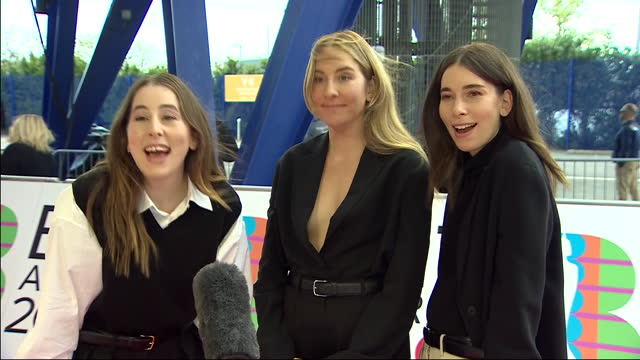 exterior shots of music artists, alana haim, este haim and danielle haim of haim arriving on the red carpet and giving an interview at the 2021 brit... - performing arts event stock videos & royalty-free footage