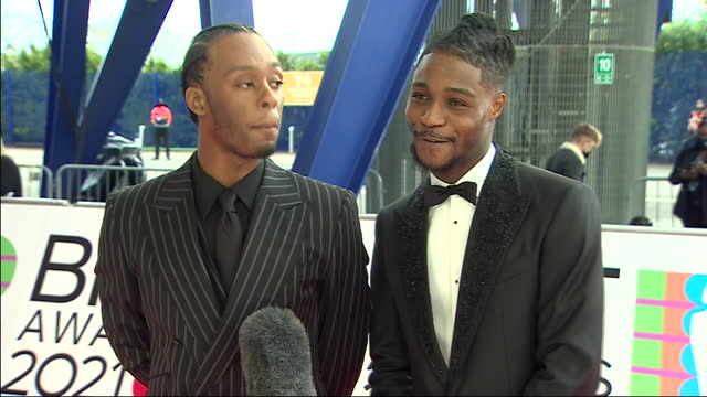 stockvideo's en b-roll-footage met exterior shots of music artists, young t & bugsey arriving on the red carpet and giving an interview at the 2021 brit awards on the 11th may 2021 in... - uitvoerende kunst voorstelling