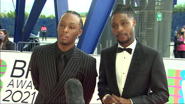 exterior shots of music artists, young t & bugsey arriving on the red carpet and giving an interview at the 2021 brit awards on the 11th may 2021 in... - performing arts event stock videos & royalty-free footage