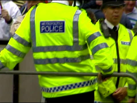 exterior shots of muslims protesting on one side of the road with the national front protesting on the other with police wearing hi vis jackets... - other stock videos & royalty-free footage