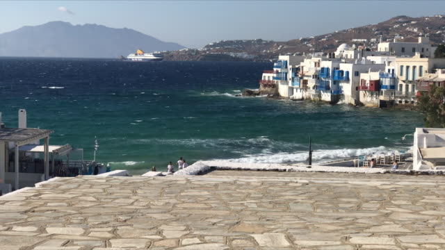 exterior shots of mykonos town and beach with tourists walking around on 22 august 2020 in mykonos greece - mykonos stock videos & royalty-free footage